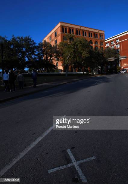 An x on Elm street where John F Kennedy was assassinated near the former Texas School Book Depository now the Dallas County Administration Building...