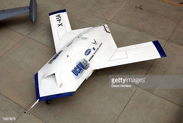 An X45A Unmanned Combat Air Vehicle is shown to members of the news media July 11 2002 at Edwards Air Force Base California The X45A developed by The...