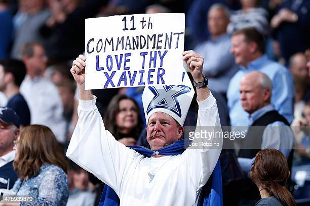 An Xavier Musketeers fan holds a sign during the game against the Creighton Bluejays at Cintas Center on March 1 2014 in Cincinnati Ohio Xavier won...