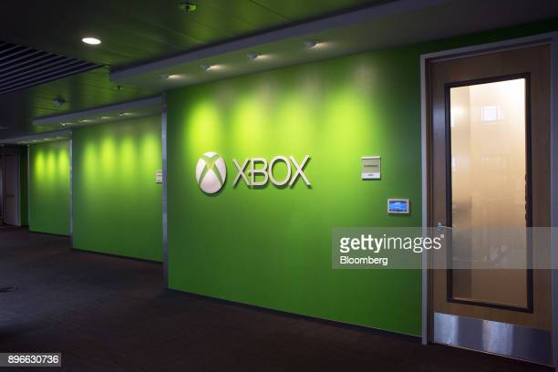 An Xbox logo is displayed in the Studio B building of the Microsoft Corp main campus in Redmond Washington US on Tuesday Dec 19 2017 In the race to...