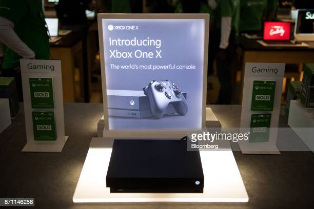 An Xbox One X game console sits on display during the Microsoft Corp global launch event in New York US on Monday Nov 6 2017 As Microsoft Corp begins...