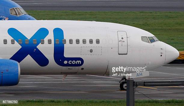 An XL airlines plane sits on the runway at Glasgow Airport as the collapse of the holiday firm led to the cancellation of flights to Tenerife on...