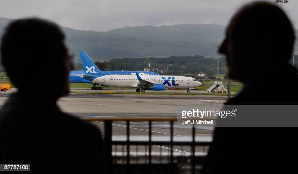 An XL airlines plane sits on the runway at Glasgow Airport due to the collapse of the holiday firm which led to cancellation of flights to Tenerife...