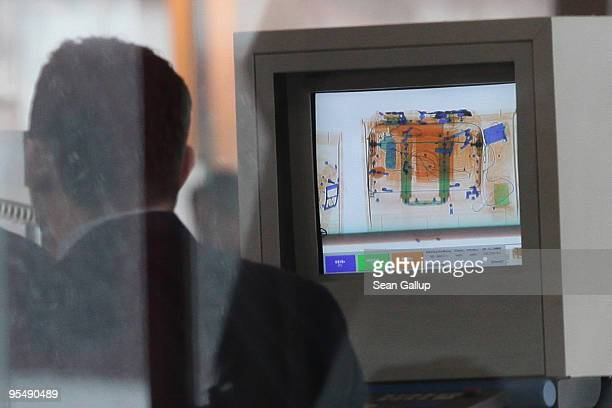 An xray machine shows a passenger's hand baggage at a security check at Tegel Airport on December 30 2009 in Berlin Germany Germany has increased...