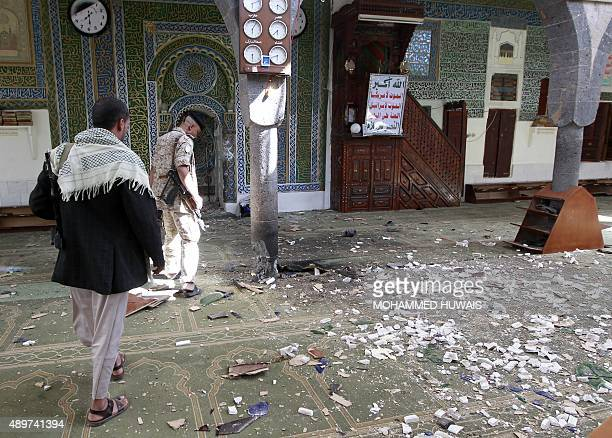 An Yemeni Huthi rebel checks the Balili mosque in the capital Sanaa following an explosion on September 24 2015 on the first day of Eid alAdha the...