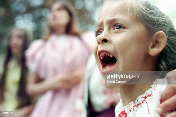 An young actor calls for the hanging of a witch during a mock medieval witch trial May 9 2001 inside the walled city of Sighisoara Romania The mock...