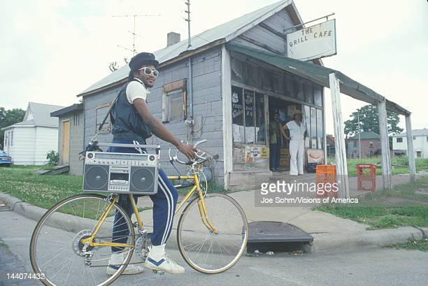 An young AfricanAmerican man on his bicycle with his boom box Cairo IL