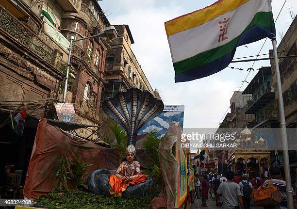 An young Indian Jain devotee dressed as Lord Krishna participates in a religious rally organised on the occasion of Mahavir Jayanti in Kolkata on...