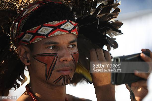 An young indigenous takes part in a demonstrations with unionists and Worker's Party members in support of President Dilma Rousseff and former...
