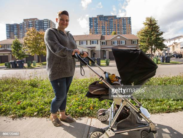 Ana Ahga out for a stroll with her infant spoke about the cost of housing in the area Ahga lives in one of the condo's seen in the background The...