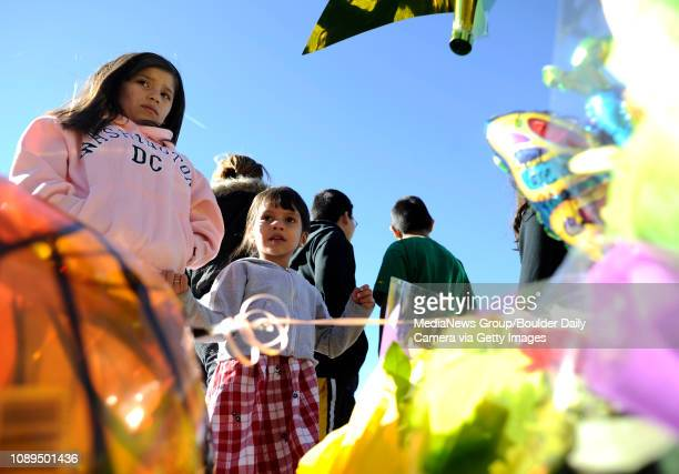 Ana Alvarado and her sister Nancy Maria stand next to a memorial for John Breaux a Louisville man who was struck and killed Friday afternoon by a...