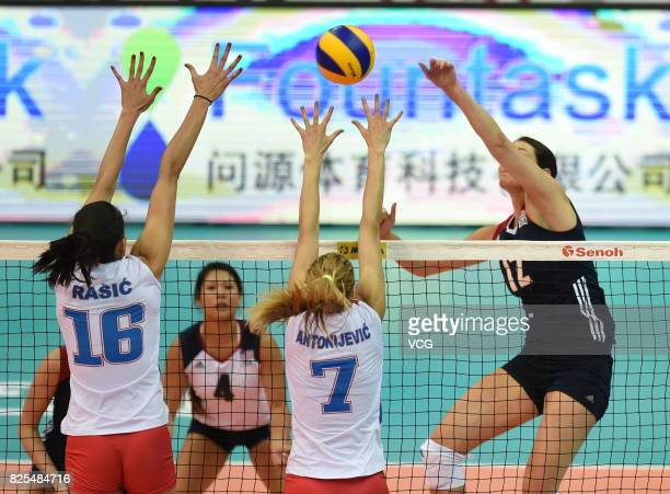Ana Antonijevic of Serbia and Milena Rasic of Serbia block the ball during the group match of 2017 Nanjing FIVB World Grand Prix Finals between...