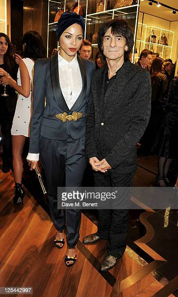 Ana Araujo and Ronnie Wood attend the opening of Roberto Cavalli's new Sloane Street boutique on September 17 2011 in London England