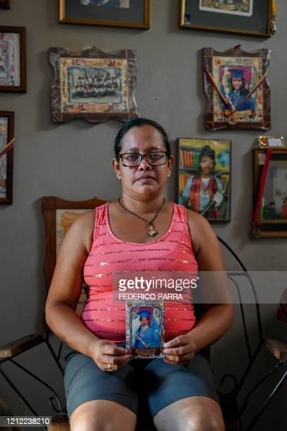 Ana Arias mother of Luisannys Betancourt, who disappeared in a shipwreck en route from Venezuela to Trinidad and Tobago on April 23 pose after an...