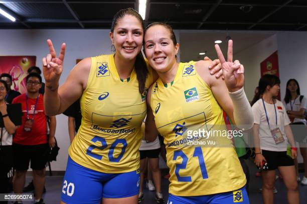 Ana Beatriz Correa and Monique Marinho Pavao of Brazil celebrate before the award ceremony 2017 Nanjing FIVB World Grand Prix Finals between Italy...
