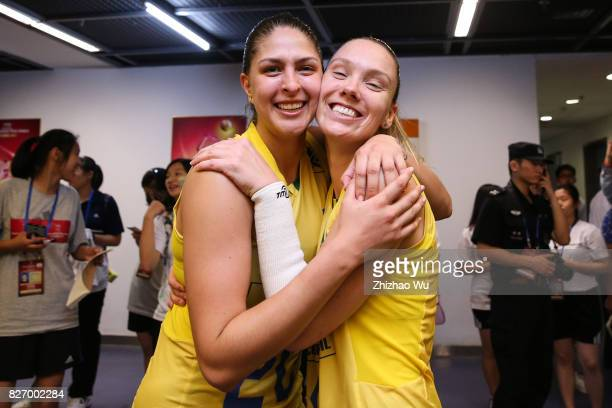 Ana Beatriz Correa and Roberta Silva Ratzke of Brazil celebrate before the award ceremony 2017 Nanjing FIVB World Grand Prix Finals between Italy and...