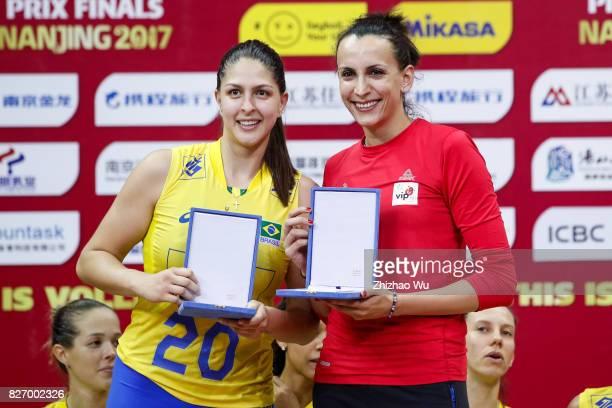 Ana Beatriz Correa of Brazil and Milena Rasic of Serbia celebrate during the award ceremony 2017 Nanjing FIVB World Grand Prix Finals between Italy...