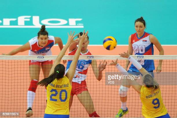 Ana Beatriz Correa of Brazil blocks the ball during the semifinal match of 2017 Nanjing FIVB World Grand Prix Finals between Serbia and Brazil at...