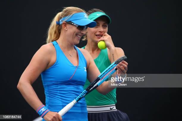 Ana Bogdan of Romania and Anastasia Rodionova of Australia talk tactics in their first round doubles match against Barbora Krejcikova and Katerina...