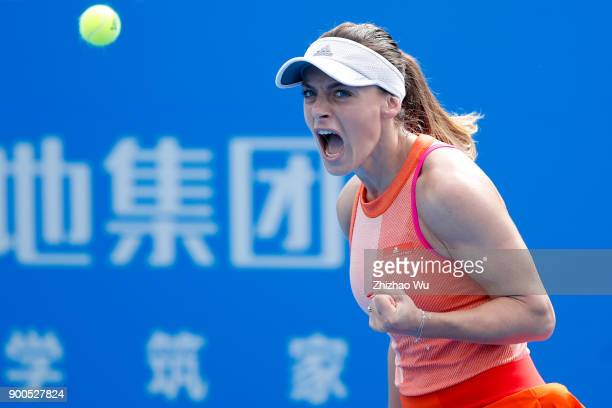 Ana Bogdan of Romania celebrates during the match against Camila Giorgi of Italy during Day 3 of 2018 WTA Shenzhen Open at Longgang International...