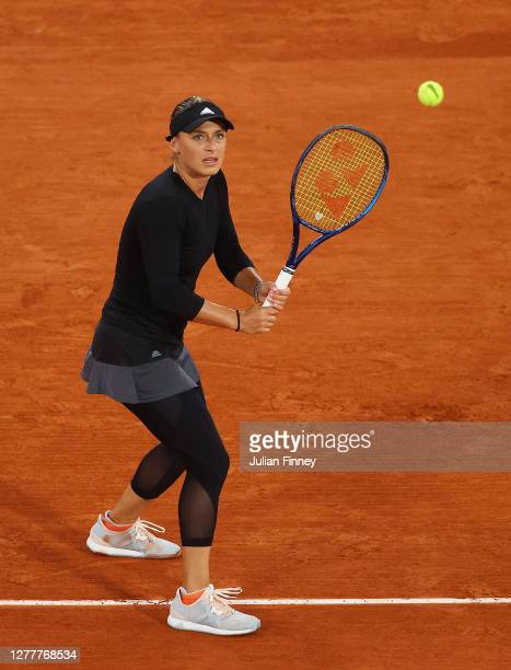 Ana Bogdan of Romania plays a backhand during her Women's Singles second round match against Sofia Kenin of The United States of America on day five...