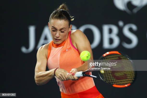 Ana Bogdan of Romania plays a backhand in her first round match against Kristina Mladenovic of France on day two of the 2018 Australian Open at...
