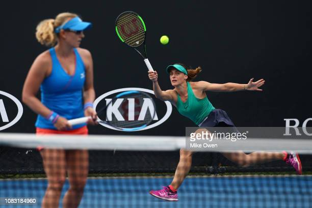 Ana Bogdan of Romania plays a forehand in her first round doubles match with Anastasia Rodionova of Australia against Barbora Krejcikova and Katerina...
