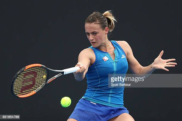 Ana Bogdan of Romania plays a forehand in her first round match against Elena Vesnina of Russia on day two of the 2017 Australian Open at Melbourne...