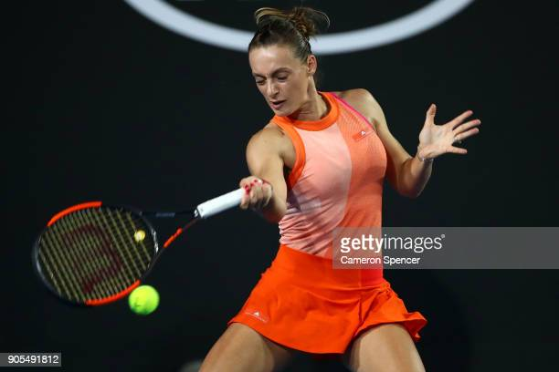 Ana Bogdan of Romania plays a forehand in her first round match against Kristina Mladenovic of France on day two of the 2018 Australian Open at...