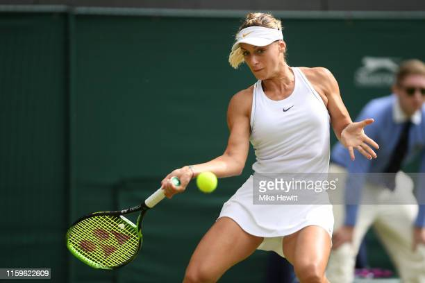 Ana Bogdan of Romania plays a forehand in her Ladies' Singles first round match against Johanna Konta of Great Britain during Day two of The...
