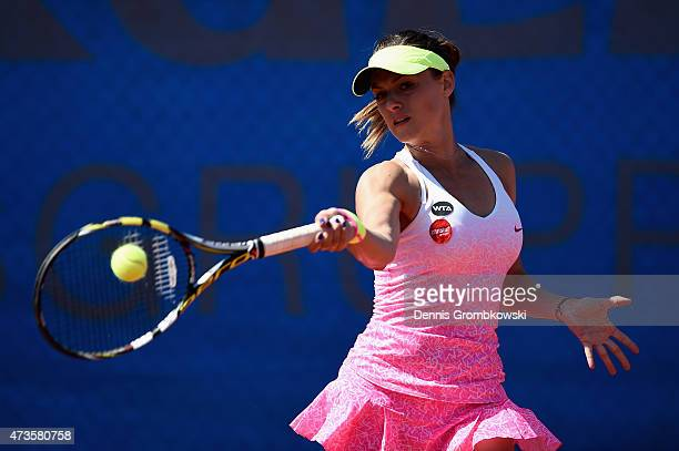 Ana Bogdan of Romania plays a forehand in her qualifier match against Rebecca Peterson of Sweden during Day One of the Nuernberger Versicherungscup...