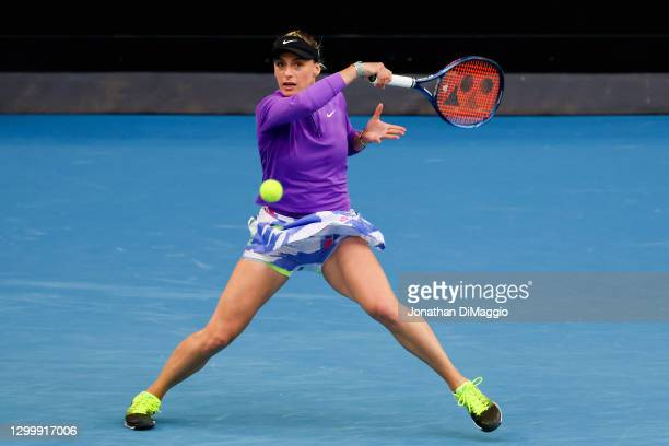 Ana Bogdan of Romania plays a forehand in her singles match against Ashleigh Barty of Australia during day three of the WTA 500 Yarra Valley Classic...