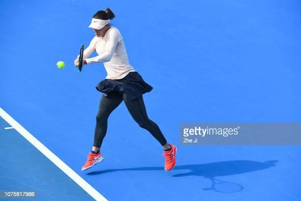 Ana Bogdan of Romania returns a shot against Anastasia Pavlyuchenkova of Russia during the women's singles 1st Round match on main draw day 1 of the...