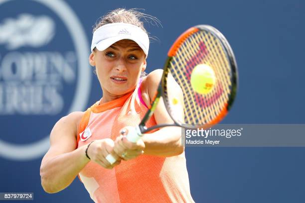 Ana Bogdan of Romania returns a shot to Kirsten Flipkens of Belgium during Day 6 of the Connecticut Open at Connecticut Tennis Center at Yale on...