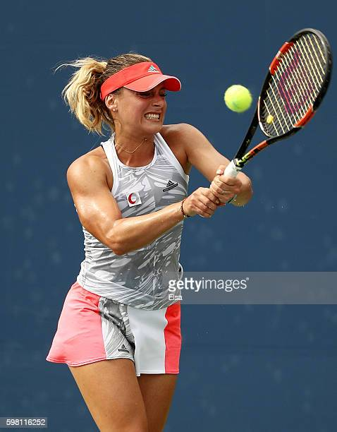 Ana Bogdan of Romania returns a shot to Monica Niculescu of Romania during her second round Women's Singles match on Day Three of the 2016 US Open at...