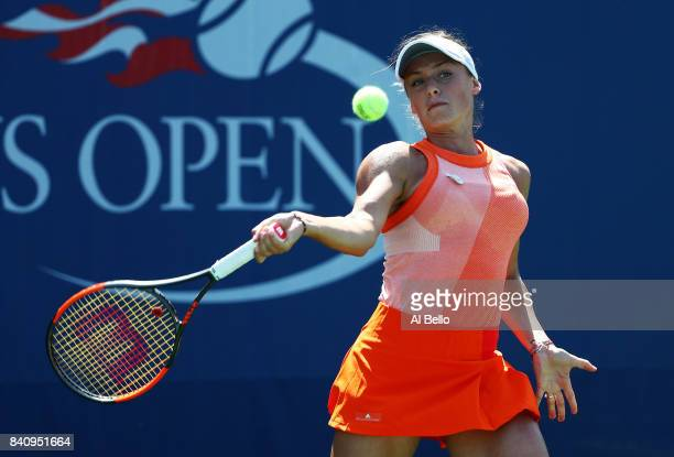 Ana Bogdan of Romania returns a shot to Taylor Townsend of the United States during their first round Women's Singles match on Day Three of the 2017...