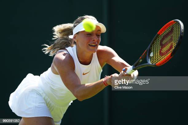 Ana Bogdan of Romania returns against Lara Arruabarrena of Spain during their Ladies' Singles first round match on day two of the Wimbledon Lawn...