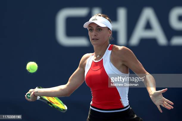 Ana Bogdan of Romania returns the ball against Harriet Dart of Great Britain during their Women's Singles first round match during day one of the...