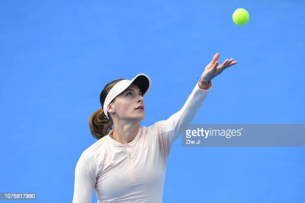 Ana Bogdan of Romania serves against Anastasia Pavlyuchenkova of Russia during the women's singles 1st Round match on main draw day 1 of the 2019 WTA...