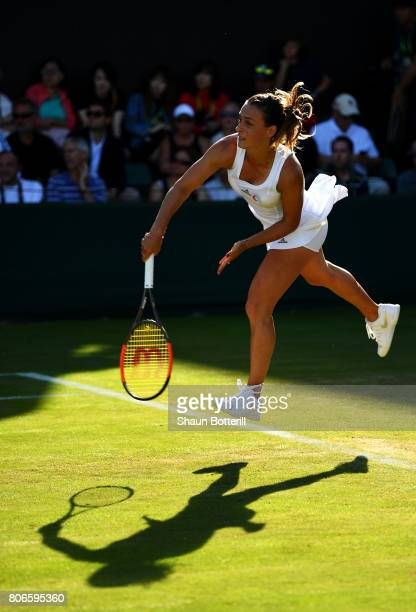 Ana Bogdan of Romania serves during the Ladies Singles first round match against Ying-Ying Duan of China day one of the Wimbledon Lawn Tennis...