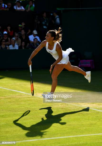 Ana Bogdan of Romania serves during the Ladies Singles first round match against YingYing Duan of China day one of the Wimbledon Lawn Tennis...