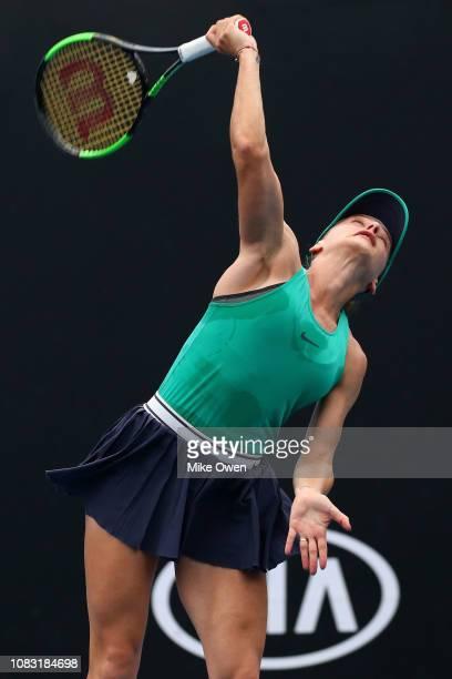Ana Bogdan of Romania serves in her first round doubles match with Anastasia Rodionova of Australia against Barbora Krejcikova and Katerina Siniakova...