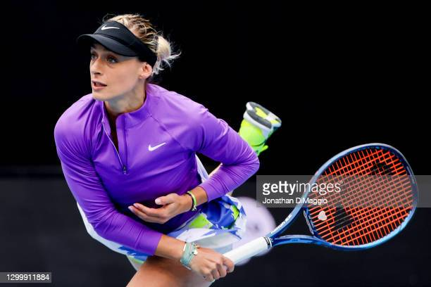 Ana Bogdan of Romania serves in her singles match against Ashleigh Barty of Australia during day three of the WTA 500 Yarra Valley Classic at...