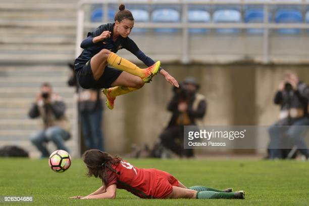 Ana Borges of Portugal competes for the ball with Chloe Logarzo of Australia during the Women's Algarve Cup Tournament match between Portugal and...