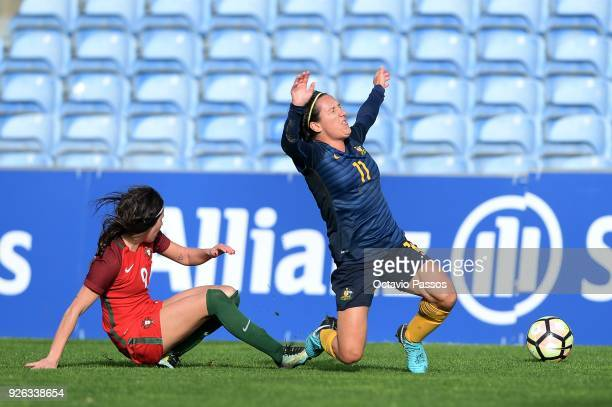 Ana Borges of Portugal competes for the ball with Lisa De Vanna of Australia during the Women's Algarve Cup Tournament match between Portugal and...