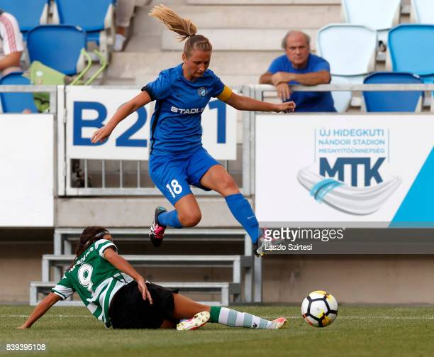 Ana Borges of Sporting CP slide tackles Anita Pinczi of MTK Hungaria FC during the UEFA Women's Champions League Qualifying match between Sporting CP...