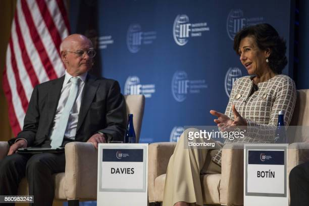 Ana Botin chairman of Banco Santander SA right speaks as Howard Davies chairman of Royal Bank of Scotland listens during the Institute of...