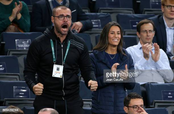 Ana Boyer along Verdasco's trainer Claudio Soliva celebrates the victory of fiance Fernando Verdasco of Spain against Dominic Thiem of Austria in 2...