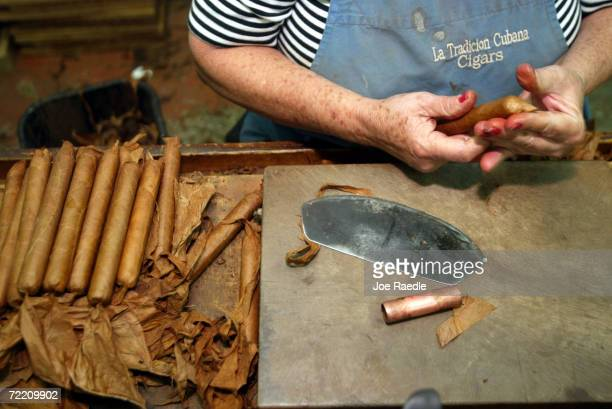 Ana Cabrera who came to America from Cuba hand rolls cigars at the La Tradicion Cubana Inc Premium Cigar Manufacturer May 28 2003 in Miami Cabrera...