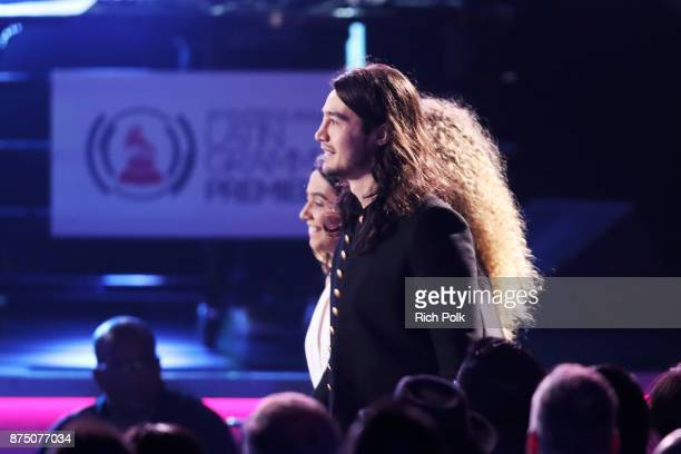 Ana Caetano Tiago Iorc and Vitoria Falcao walk onstage to accept Best Song in the Portuguese Language for 'Trevo ' at the Premiere Ceremony during...